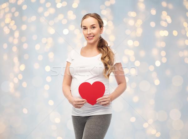Boldog terhes nő piros szív terhesség szeretet Stock fotó © dolgachov
