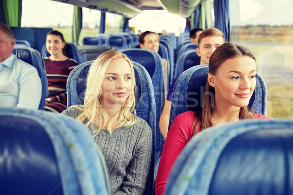 happy young women riding in travel bus Stock photo © dolgachov