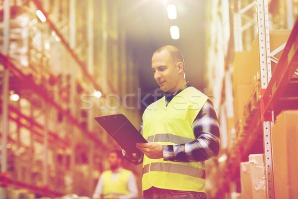 Férfi vágólap mentőmellény raktár nagybani eladás emberek Stock fotó © dolgachov
