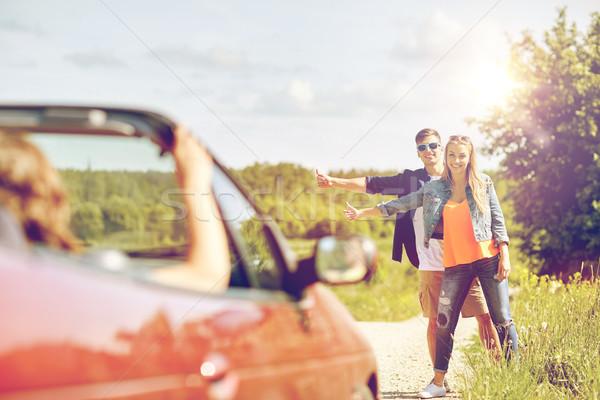 Pár tömés autó vidék út utazás Stock fotó © dolgachov