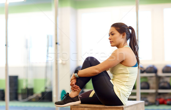 woman with heart rate tracker or smartwatch in gym Stock photo © dolgachov
