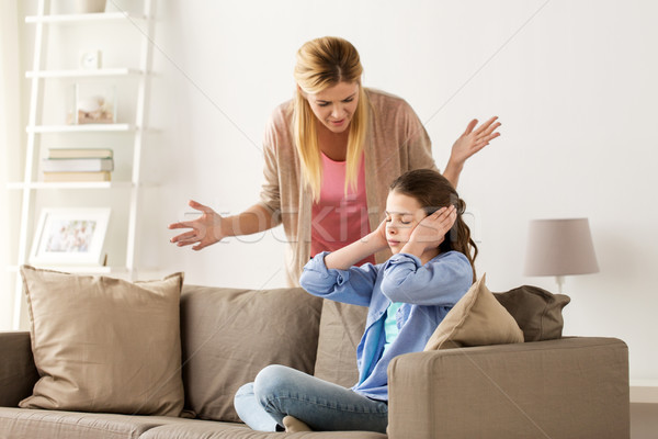 girl closing ears to not hear angry mother at home Stock photo © dolgachov