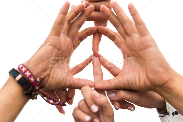 hands of hippie friends showing peace sign Stock photo © dolgachov