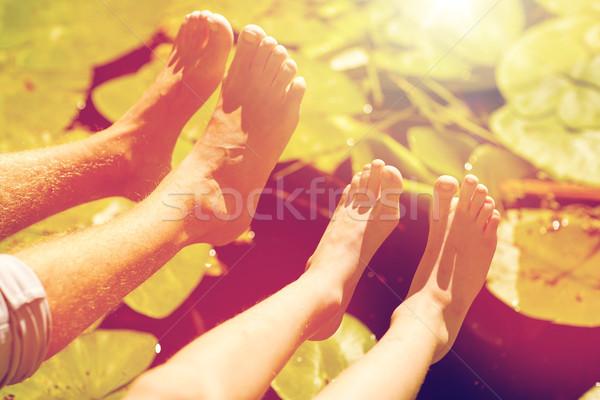 Grand-père petit-fils pieds rivière famille génération Photo stock © dolgachov
