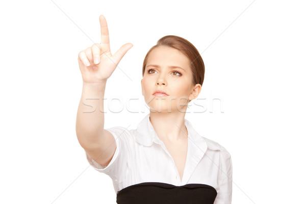 Femme d'affaires travail quelque chose imaginaire photos femme Photo stock © dolgachov