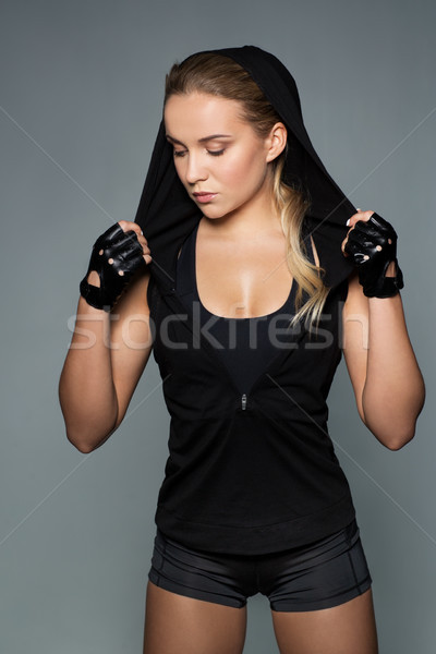 young woman in black sportswear posing Stock photo © dolgachov