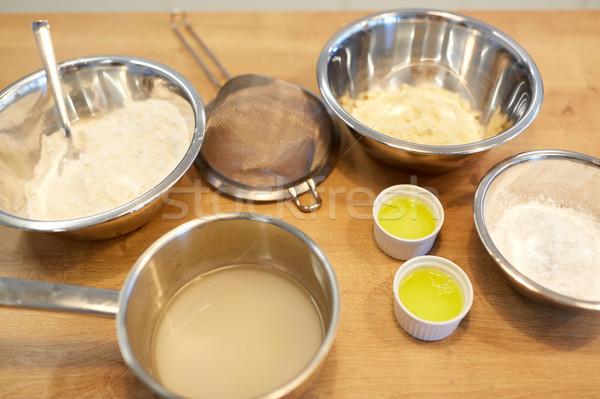 bowls with flour and egg whites at bakery kitchen Stock photo © dolgachov