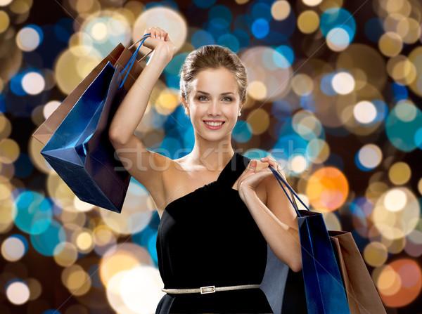 Mutlu kadın siyah elbise satış moda Stok fotoğraf © dolgachov