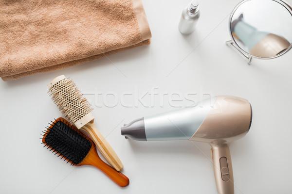 hairdryer, hair brushes, mirror and towel Stock photo © dolgachov