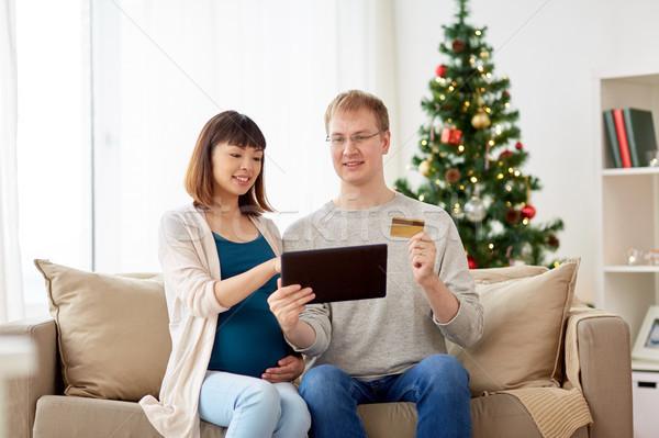 Stok fotoğraf: Adam · hamile · eş · alışveriş · çevrimiçi · Noel