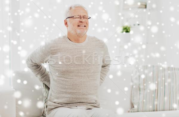 unhappy senior man suffering from backache at home Stock photo © dolgachov