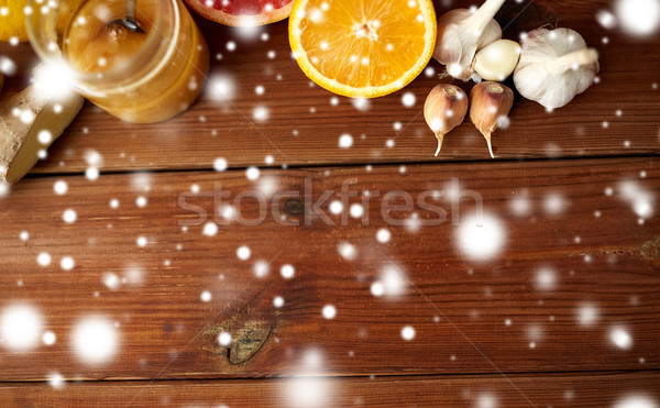 Miel fruits gingembre ail bois Photo stock © dolgachov