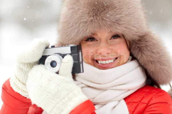 happy woman with film camera outdoors in winter Stock photo © dolgachov