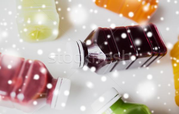bottles of different fruit or vegetable juices Stock photo © dolgachov
