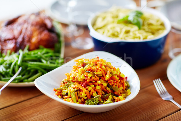 vegetable salad with corn and other food on table Stock photo © dolgachov