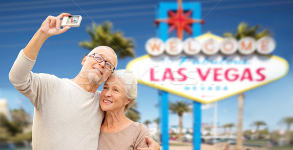 senior couple taking selfie by camera at las vegas Stock photo © dolgachov