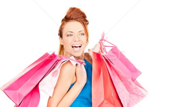 Vásárló boldog nő bevásárlótáskák fehér lány Stock fotó © dolgachov