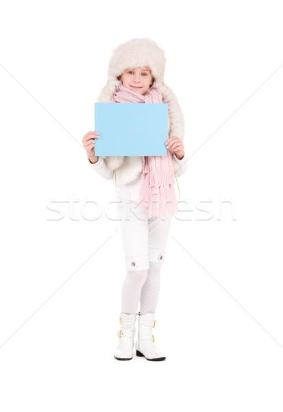 girl in winter hat with blank board Stock photo © dolgachov