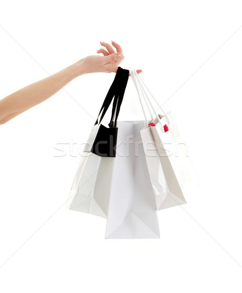 hand with shopping bags Stock photo © dolgachov