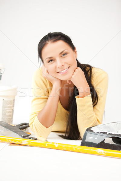 lovely housewife making repairing works Stock photo © dolgachov