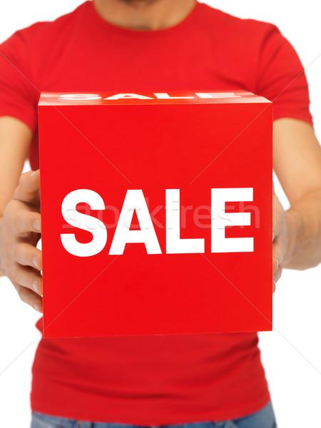 man holding sale sign Stock photo © dolgachov
