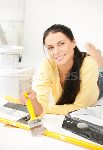 woman with paintbrush and renovating tools Stock photo © dolgachov