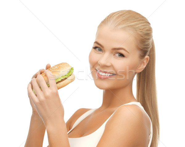 woman eating junk food Stock photo © dolgachov