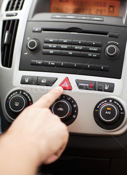 man pressing car hazard warning button Stock photo © dolgachov