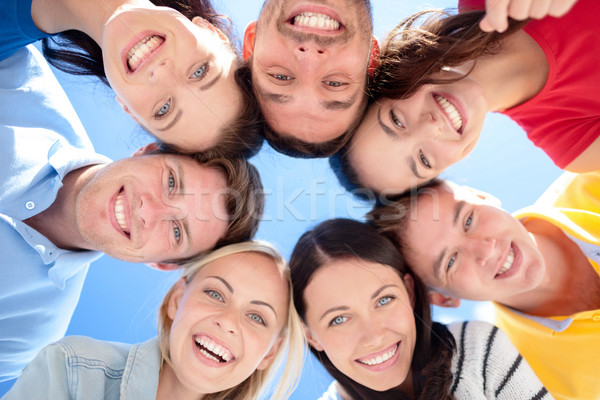 group of teenagers looking down Stock photo © dolgachov