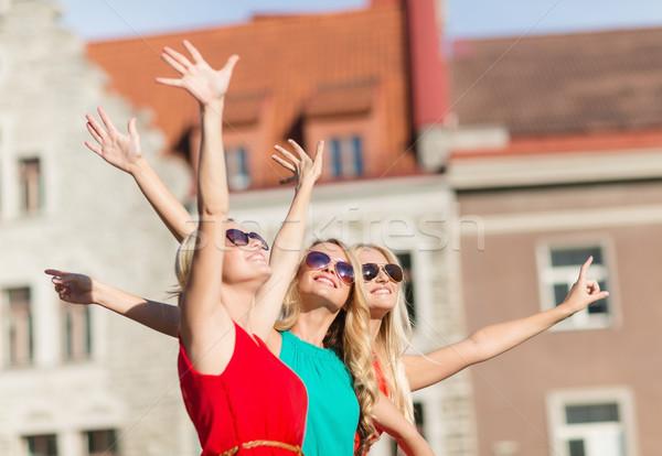 three beautiful women in the city Stock photo © dolgachov