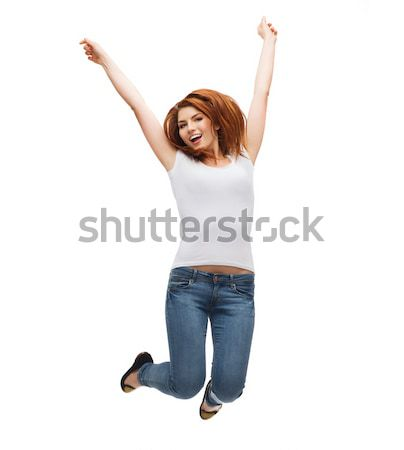 teenage girl in white blank t-shirt jumping Stock photo © dolgachov