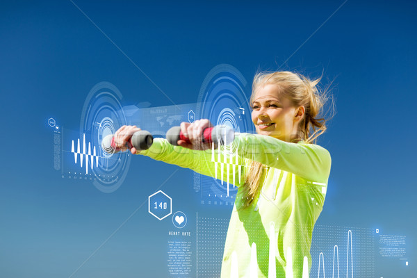 Kobieta świetle hantle odkryty sportu Zdjęcia stock © dolgachov