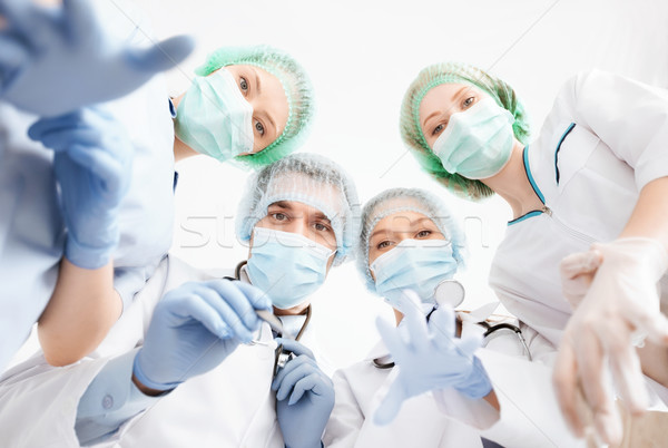 group of doctors in operating room Stock photo © dolgachov