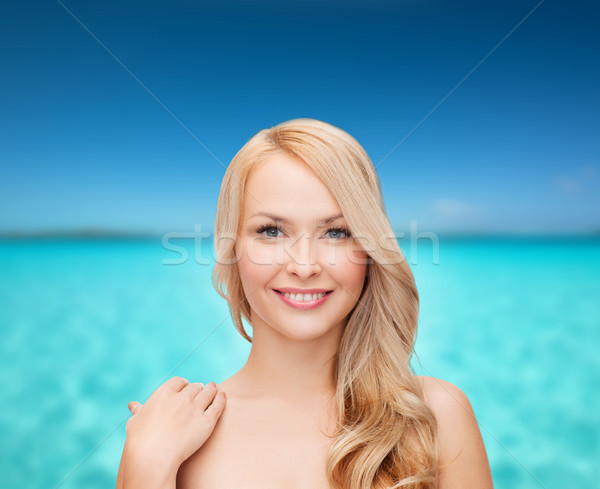 face and shoulders of happy woman with long hair Stock photo © dolgachov