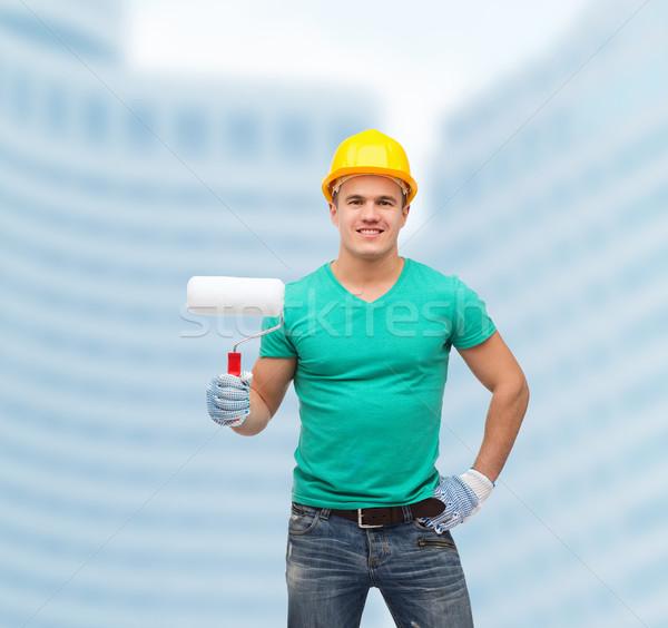 Sorridere manuale lavoratore casco vernice riparazione Foto d'archivio © dolgachov