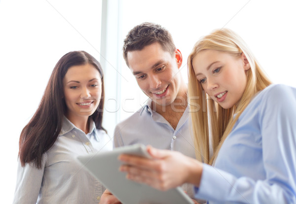 business team working with tablet pc in office Stock photo © dolgachov