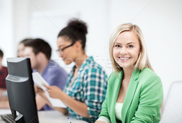 student with computer studying at school Stock photo © dolgachov