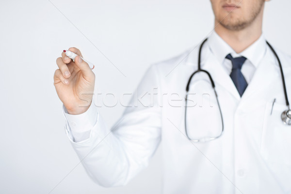 doctor writing something in the air Stock photo © dolgachov