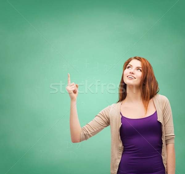 Sonriendo senalando dedo hasta escuela Foto stock © dolgachov