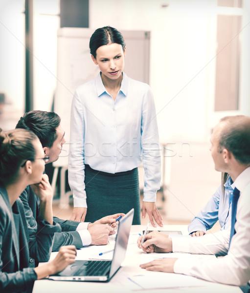 strict female boss talking to business team Stock photo © dolgachov