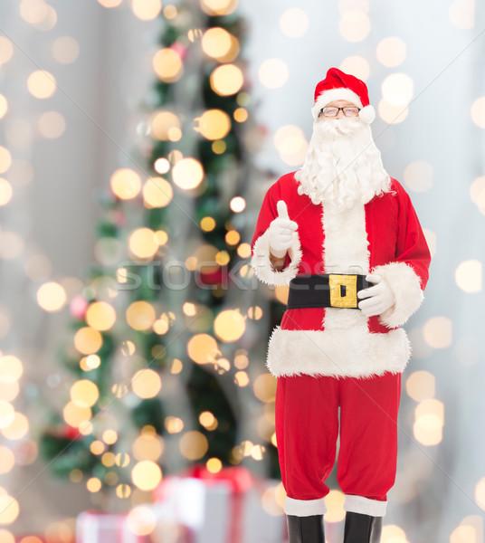 Hombre traje papá noel Navidad vacaciones gesto Foto stock © dolgachov