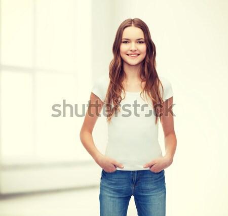Uśmiechnięty nastolatek biały tshirt projektu szczęśliwy Zdjęcia stock © dolgachov