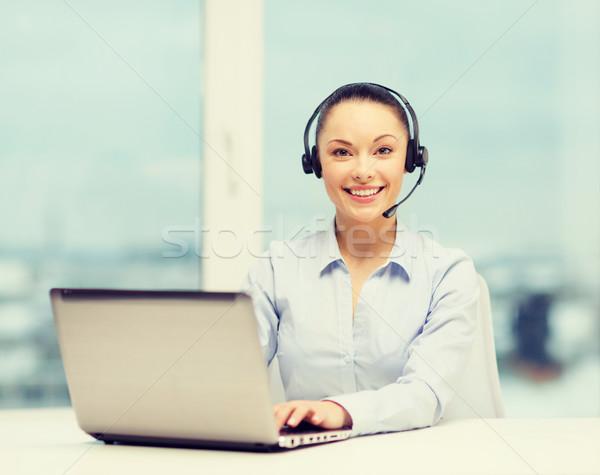 Stock photo: friendly female helpline operator
