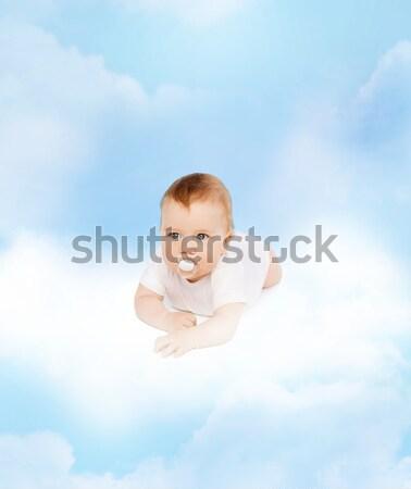 Feliz pequeno menino branco tshirt bíceps Foto stock © dolgachov