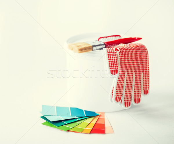 paintbrush, paint pot, gloves and pantone samplers Stock photo © dolgachov