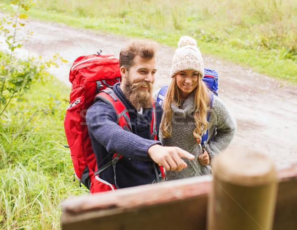 smiling couple with backpacks hiking Stock photo © dolgachov