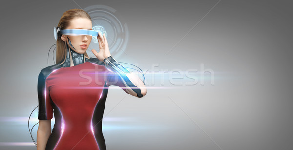 woman with futuristic glasses and sensors Stock photo © dolgachov