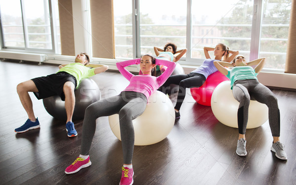 счастливые люди брюшной мышцы фитнес спорт подготовки Сток-фото © dolgachov