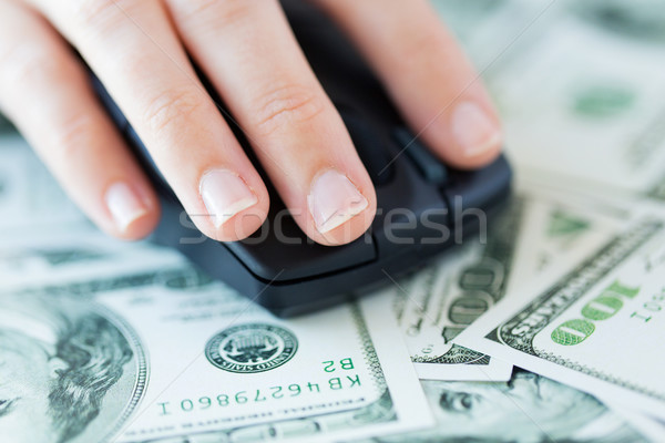 close up of hand with computer mouse on money Stock photo © dolgachov