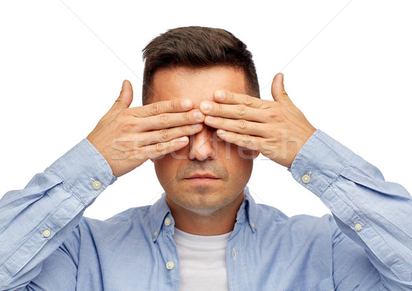 face of man covering his eyes with hands Stock photo © dolgachov
